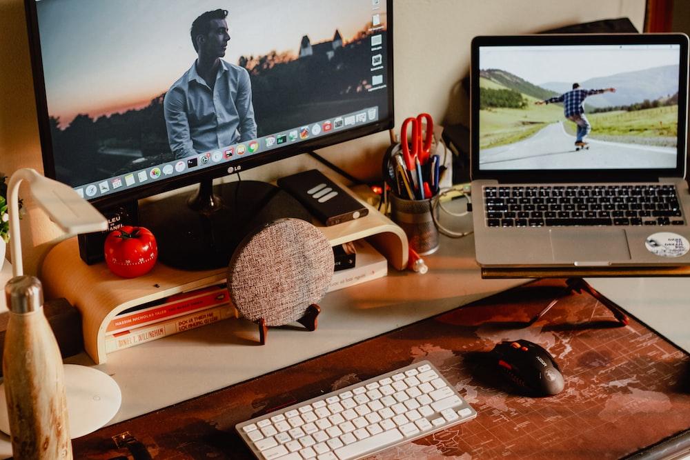 MacBook Pro and black flat screen monitor