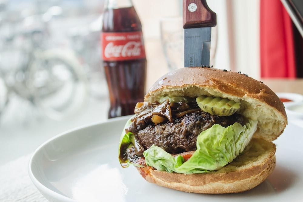 burger near Coca-Cola bottle