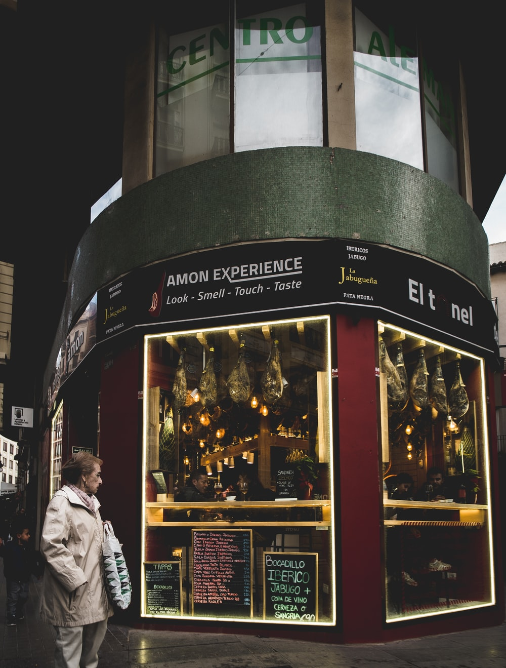 man standing in front of Amon Experience shop front