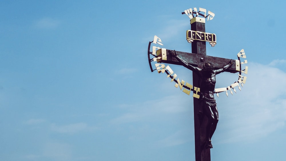 black wooden crucifix