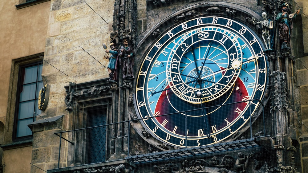 round black and blue clock tower