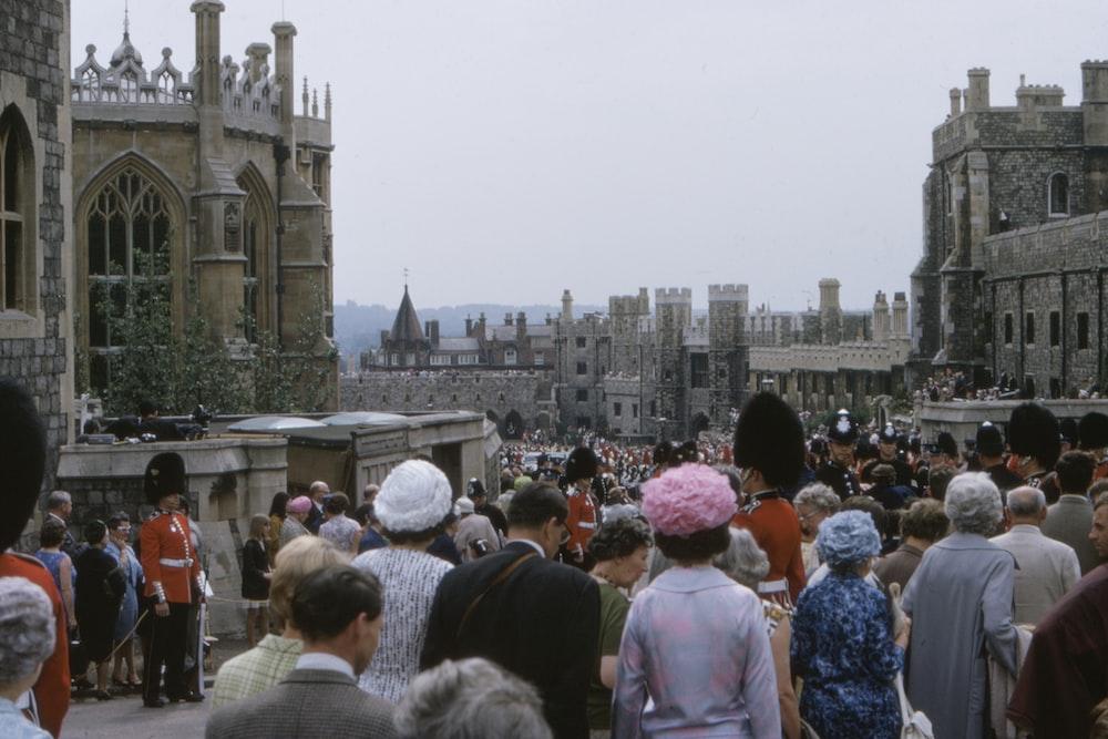 crowd walking on street at daytime