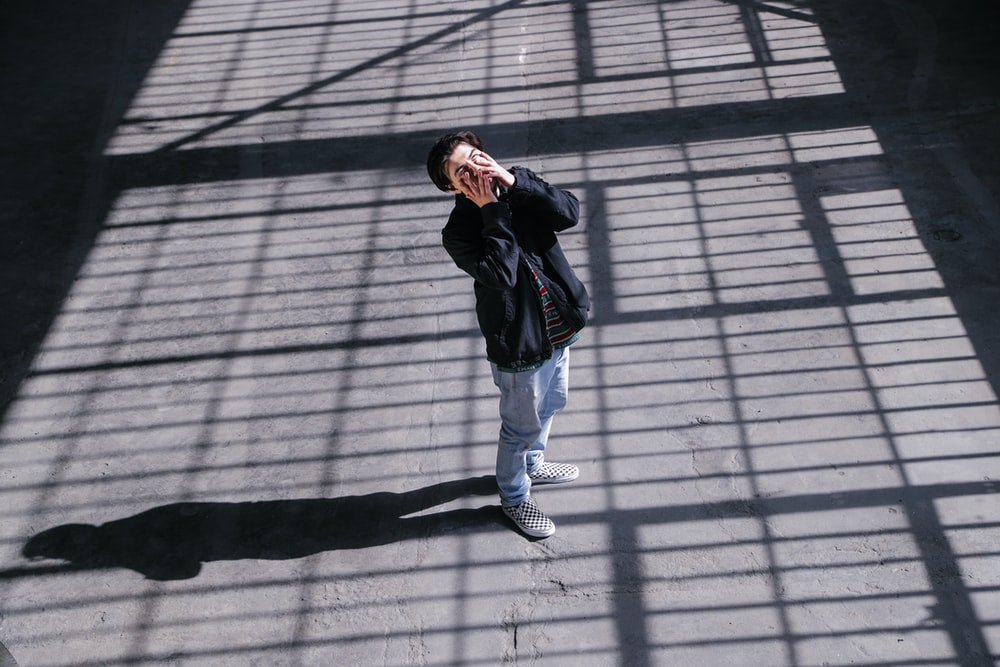 high-angle photography of black zip-up jacket