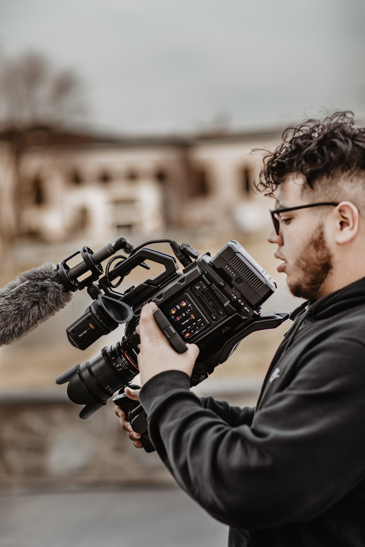 man holding professional camera