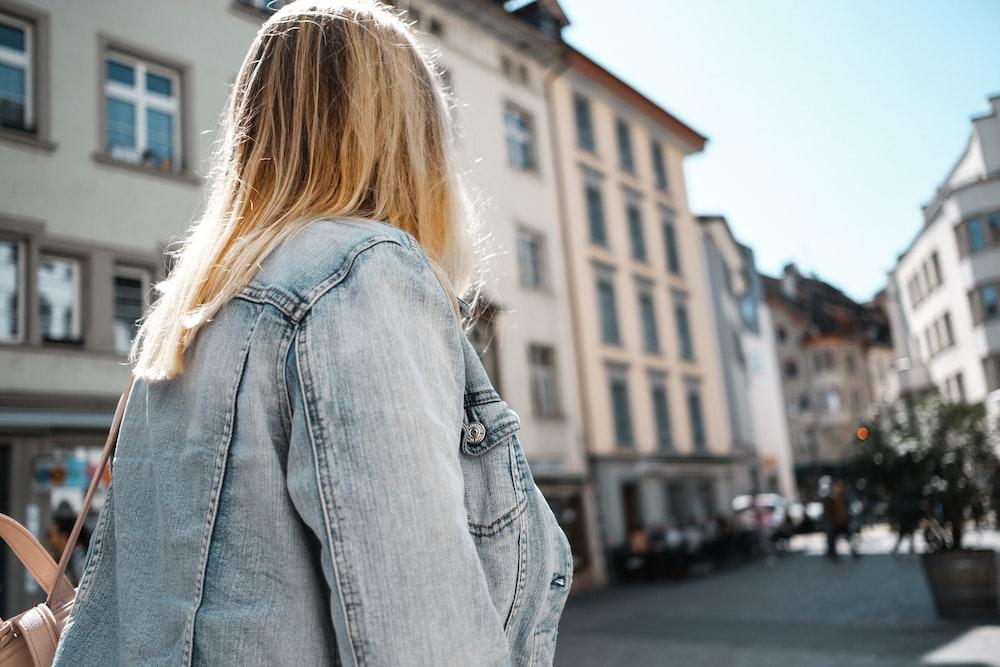 person in blue denim jacket