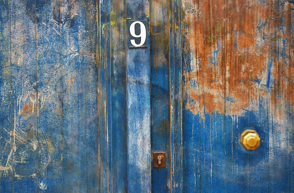 blue-painted metal door with number 9