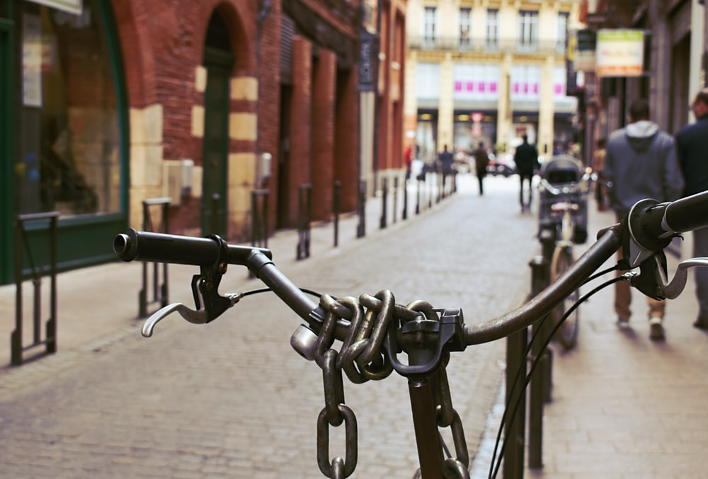 black bike parked near buildings