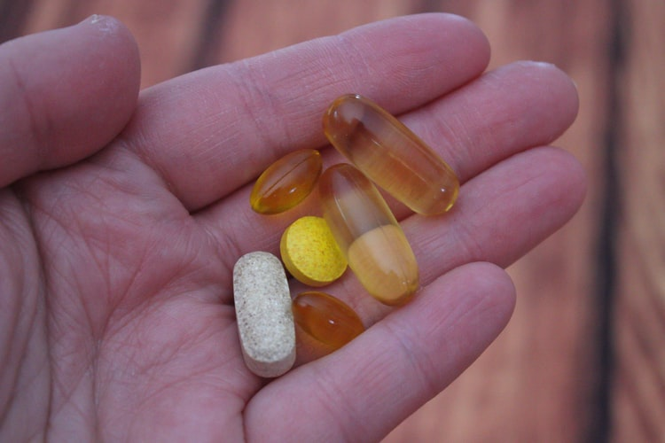 someone having vitamin in his hand