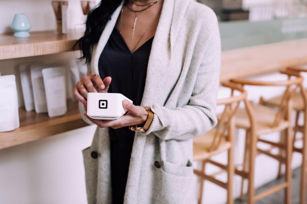 woman using white device