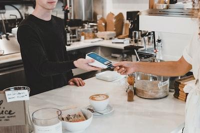 man paying using credit card