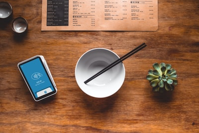 black chopsticks in white ceramic bowl on table