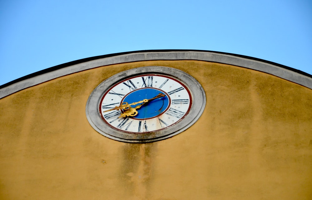 round white and blue analog wall clock