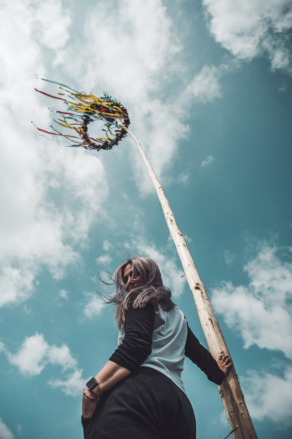 woman standing near pole