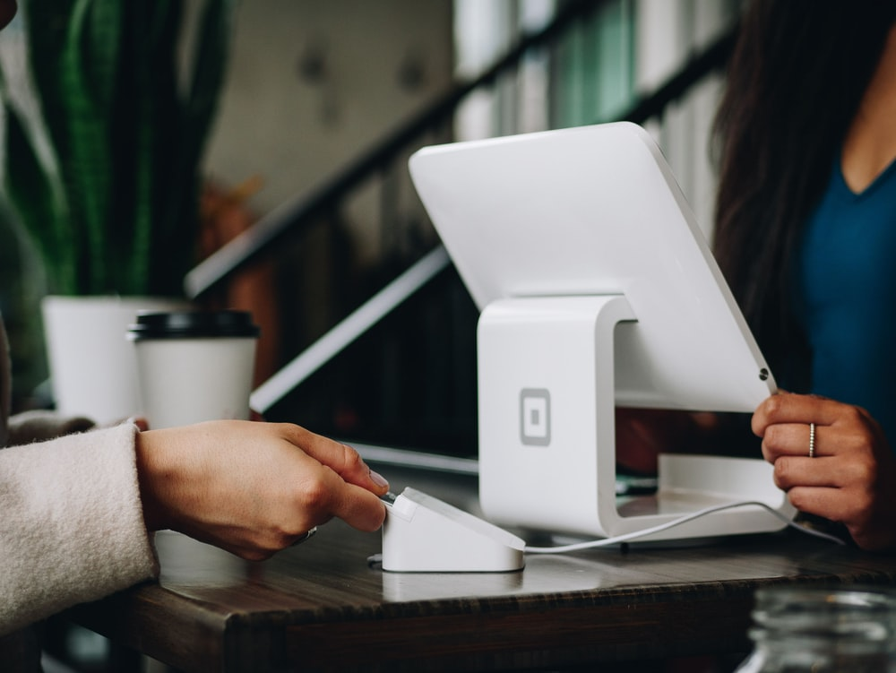 white monitor on desk