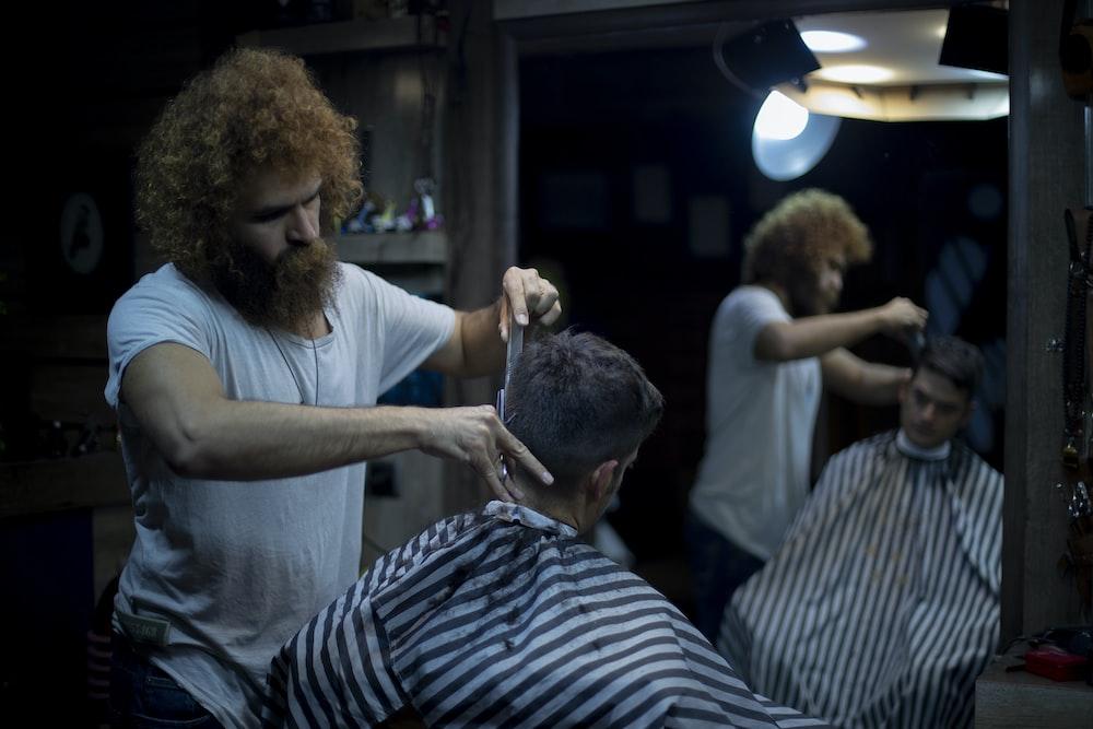 person having hair cut