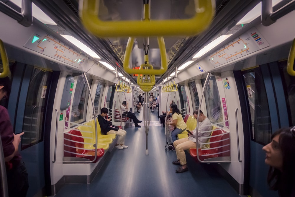 people sitting on benches in singapore mrt train
