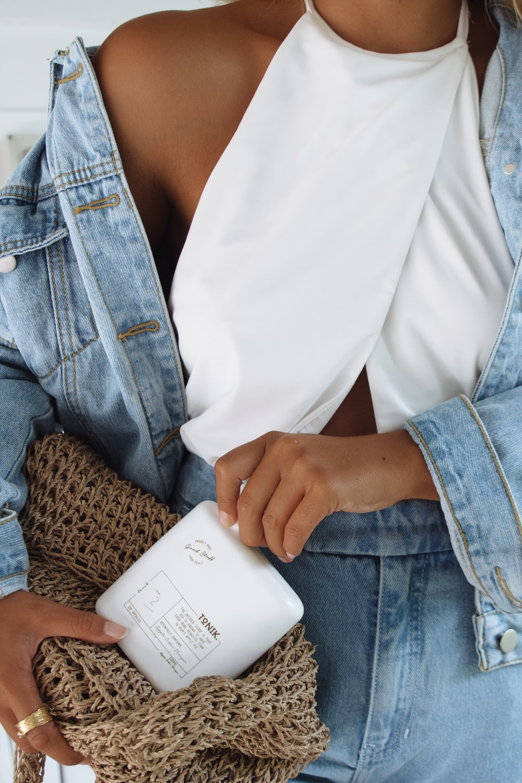 woman in denim jacket