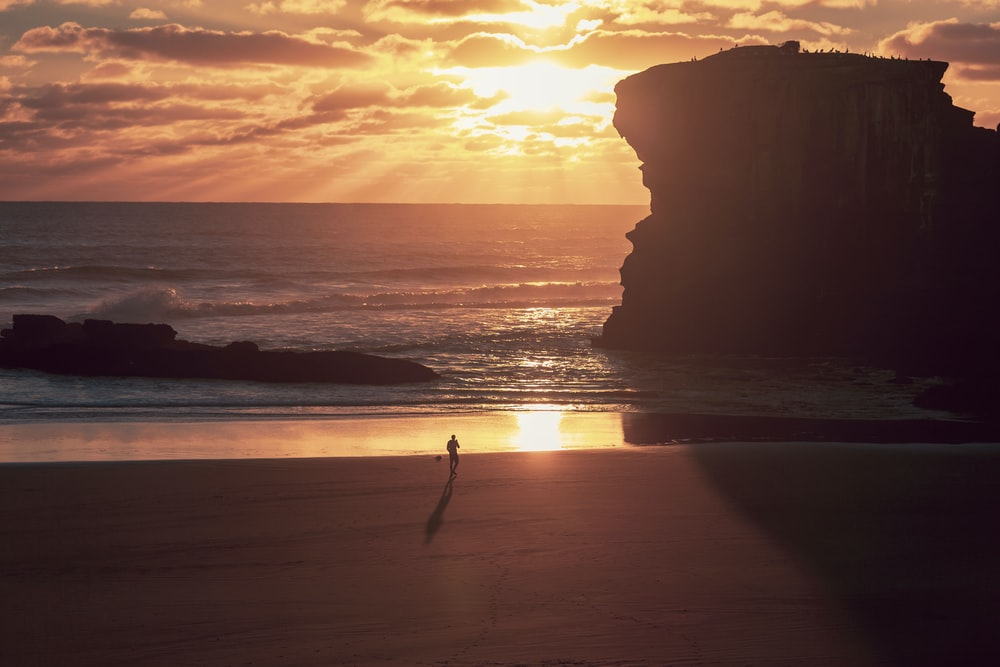seashore under orange sky