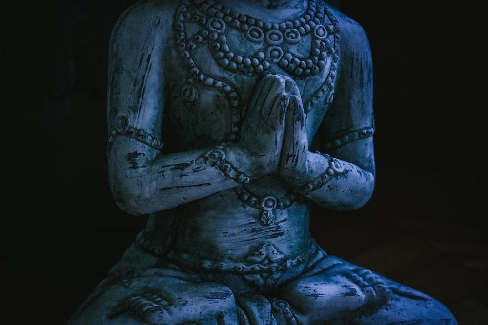 sitting human statue
