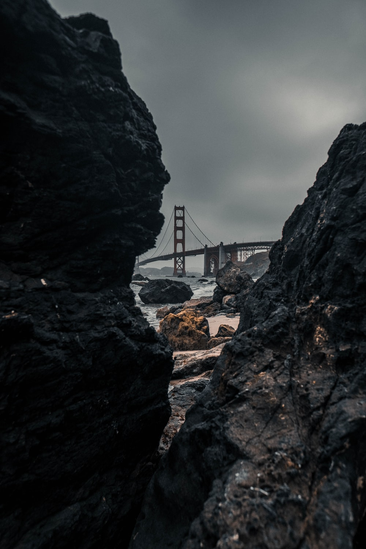 gray bridge near body of water
