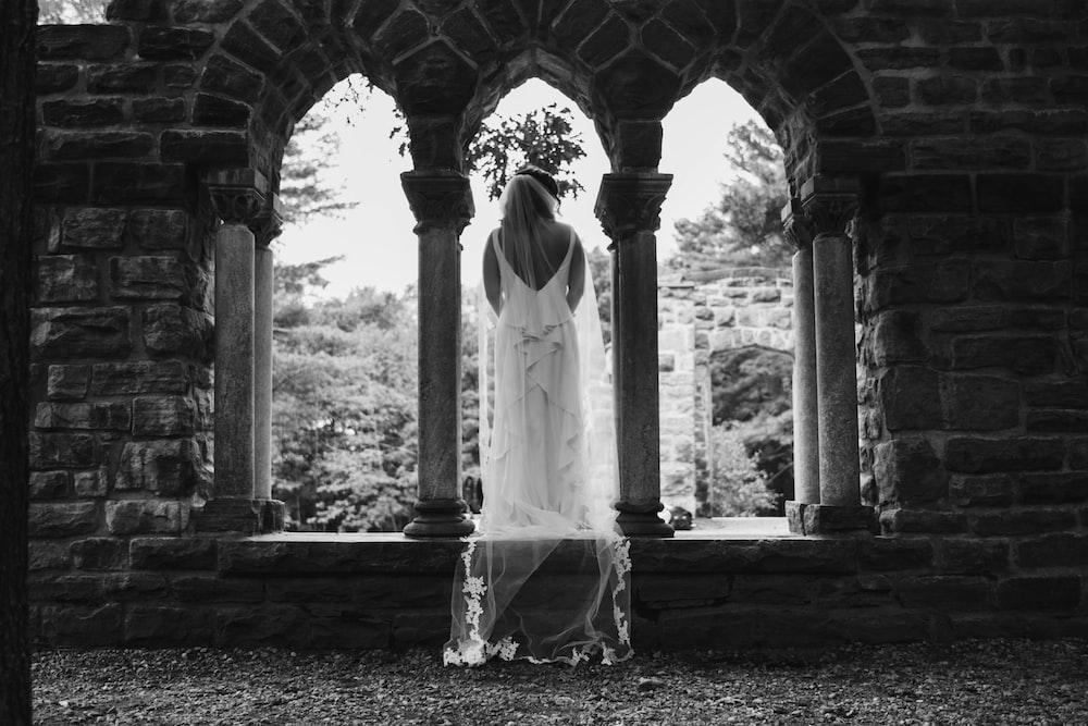woman standing wearing wedding dress