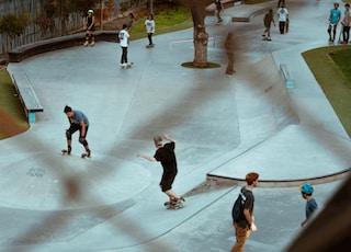 men playing skateboard near skateboard play yard during daytime
