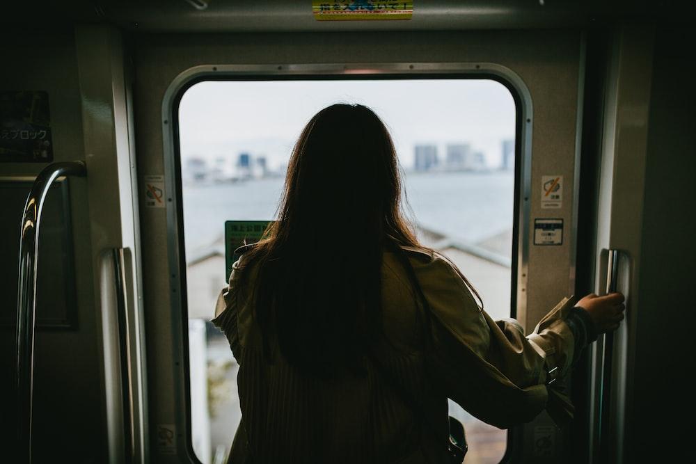 woman in front of train door