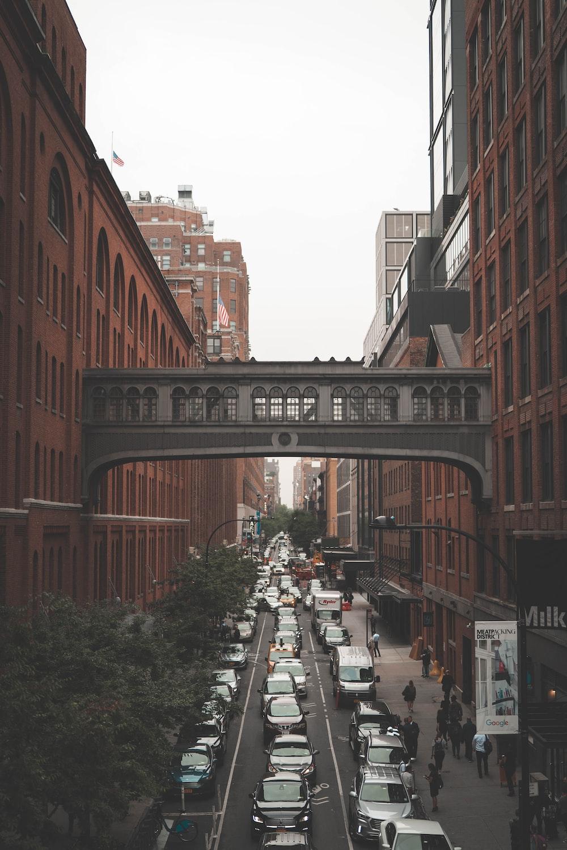 vehicles under gray bridge