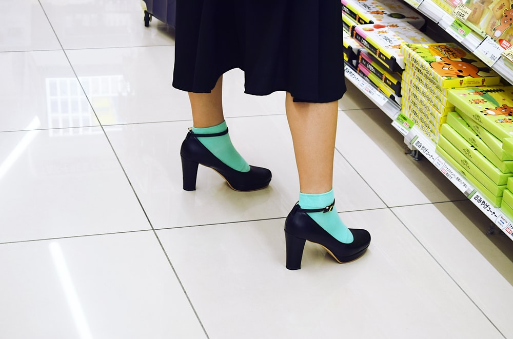 woman wearing blue high heeled shoes