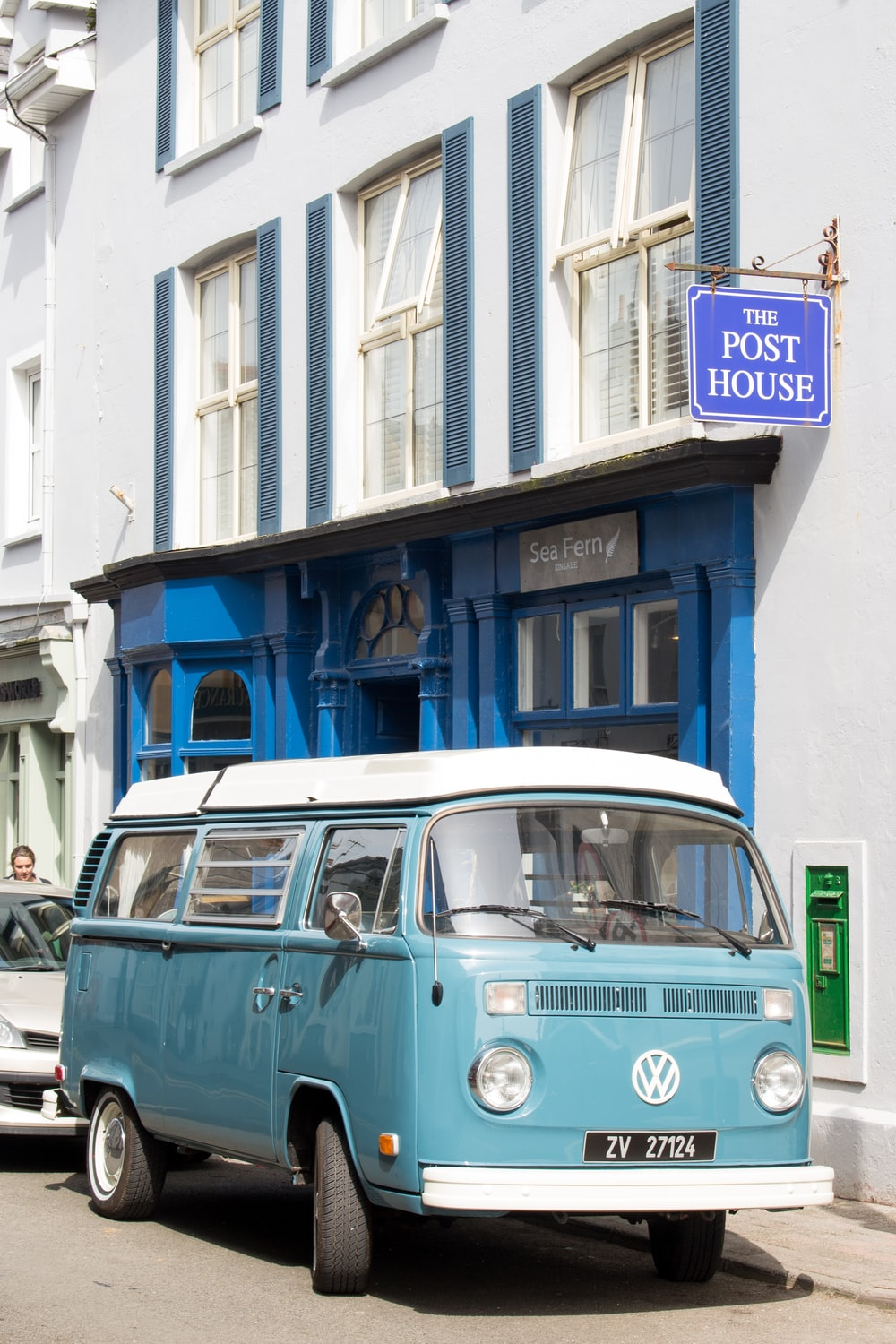 blue and white Volkswagen van besides The Post House