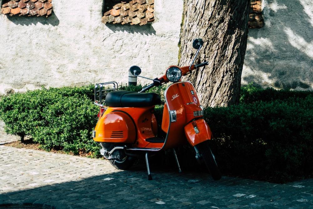 orange motor scooter