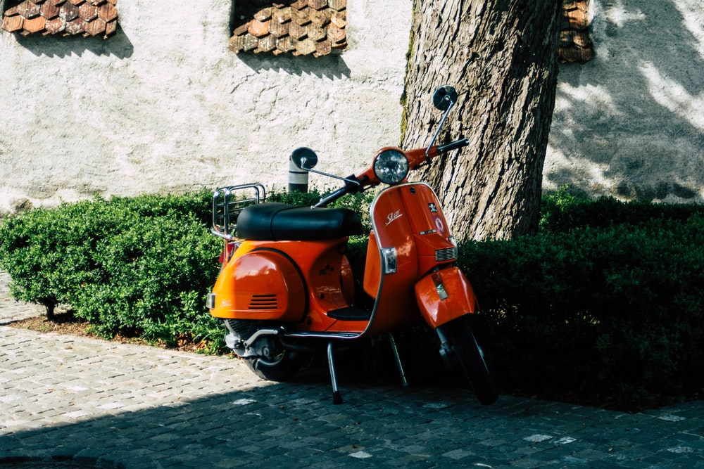 orange motor scooter
