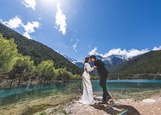 man and woman near lake
