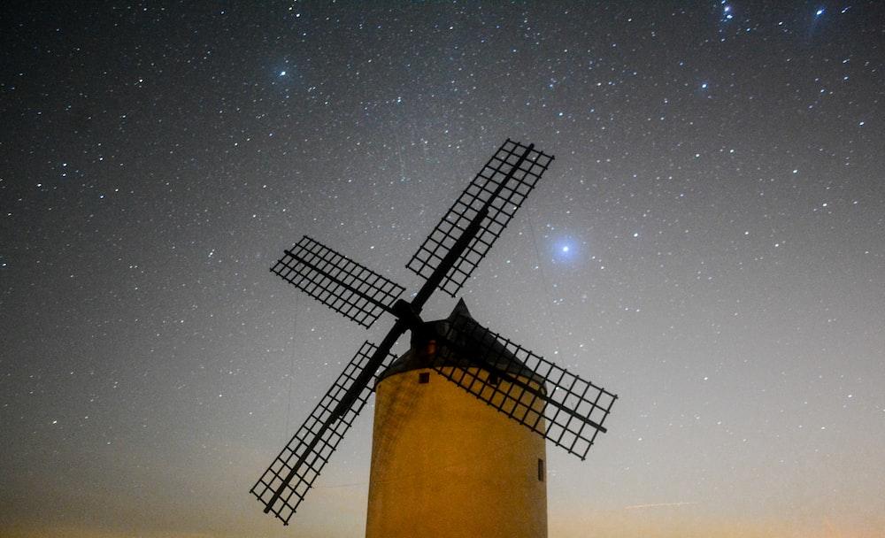 black windmill under stars