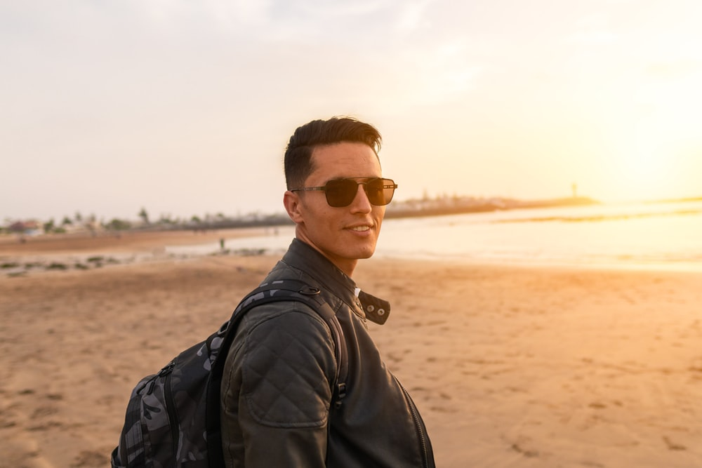 smiling man standing near seashore
