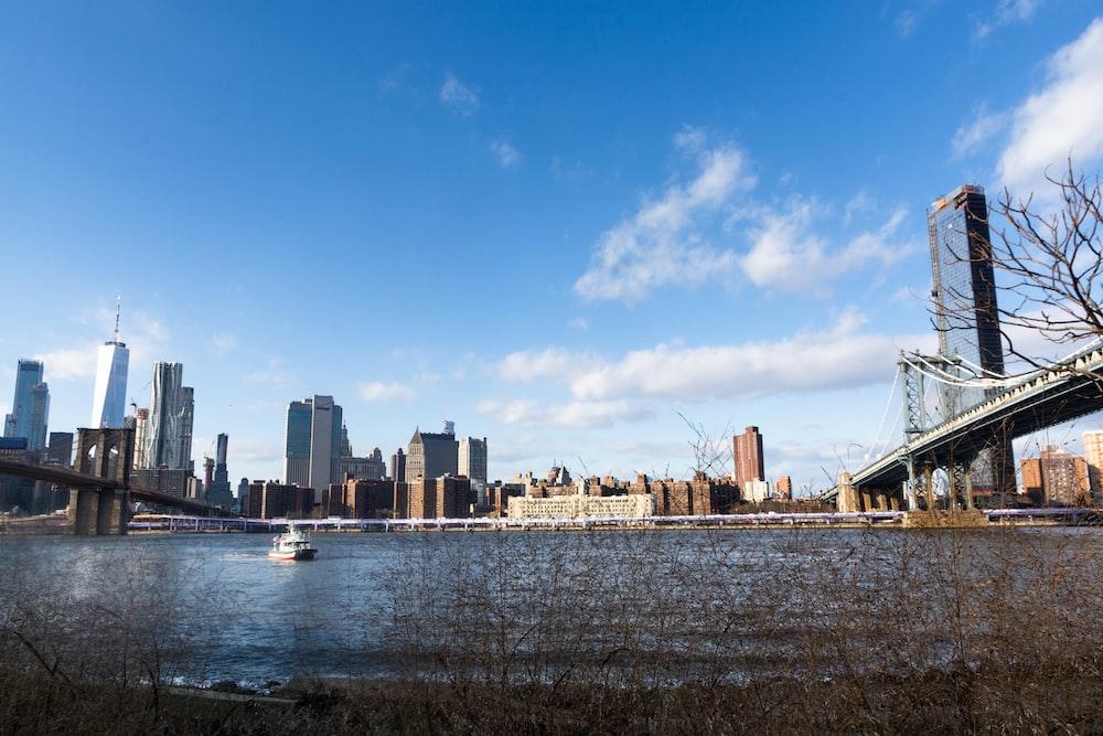 Brooklyn Bridge viewing city under blue and white skies
