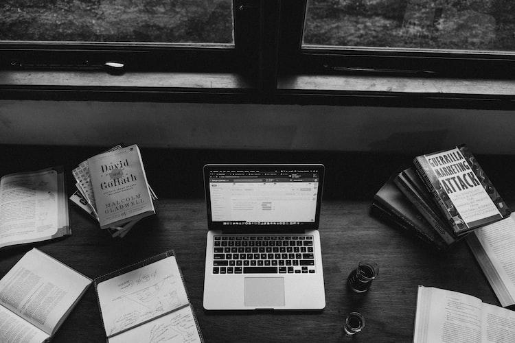 MacBook Pro near books