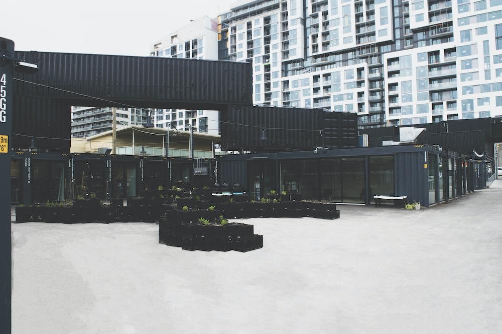 black concrete building near high-rise buildings
