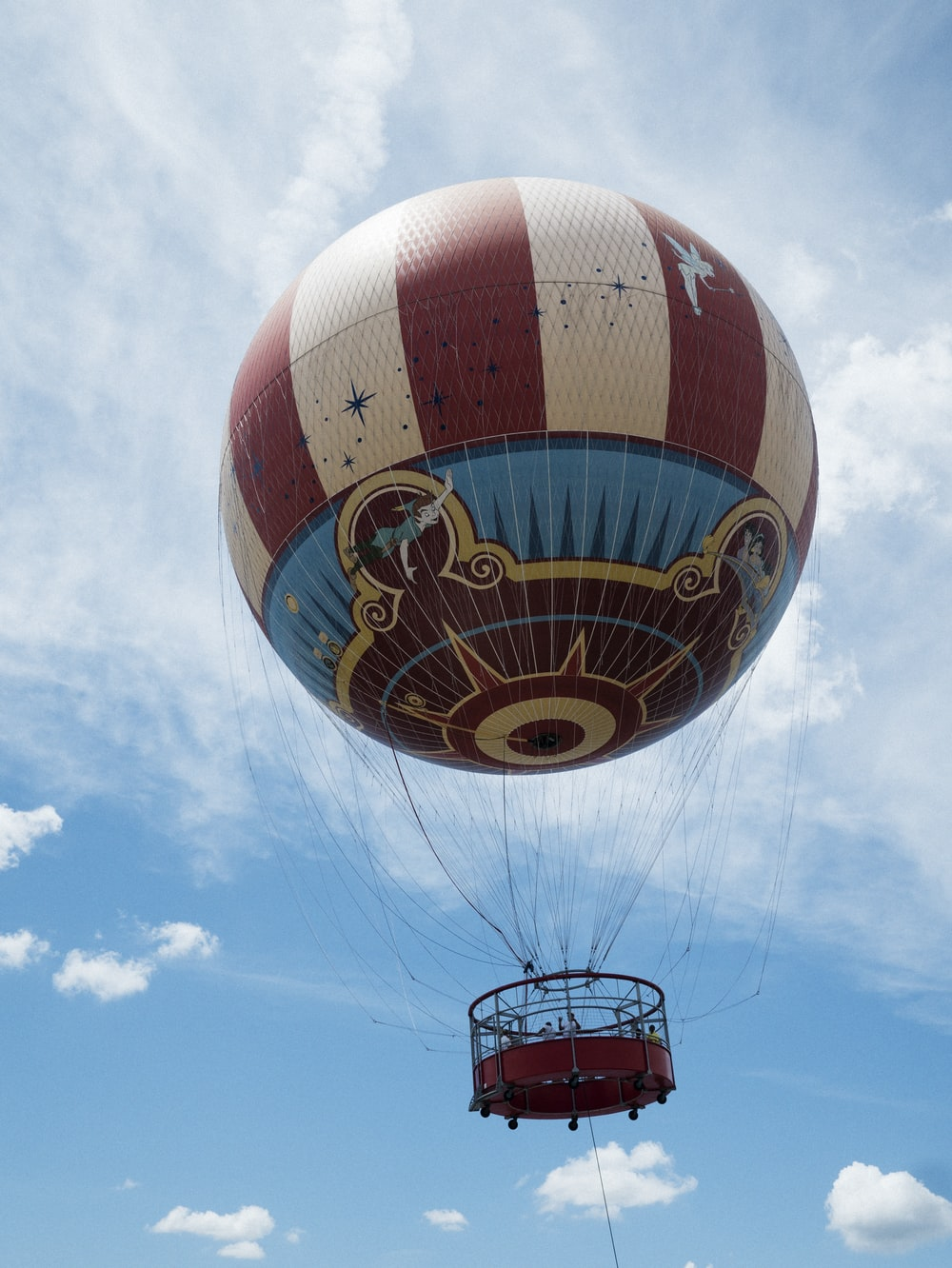brown and beige hot air ballooning during daytime