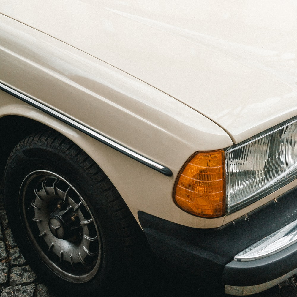 white vehicle showing headlight