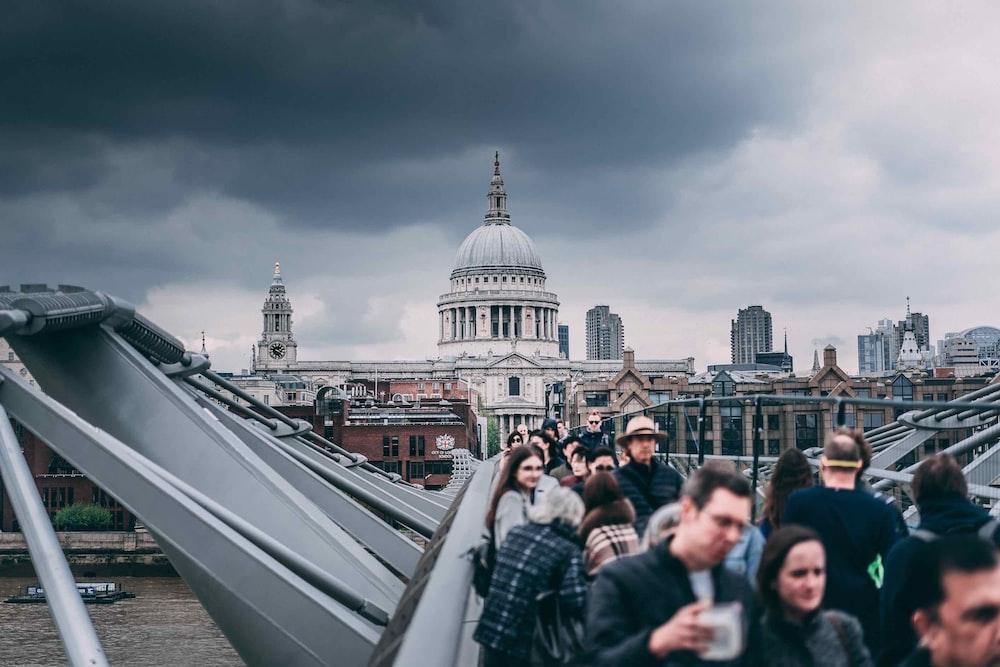 people walking steel bridge