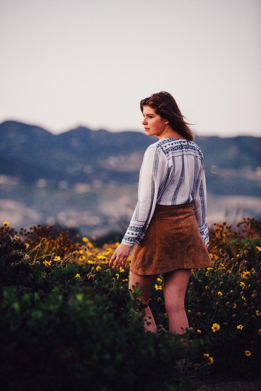 woman wearing brown miniskirt