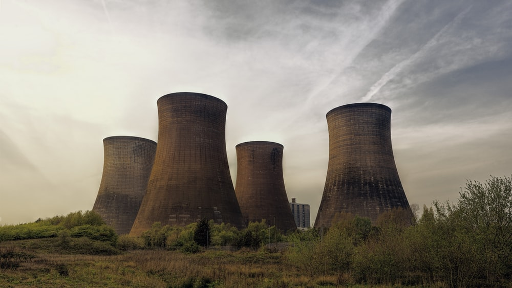 four brown concrete towers