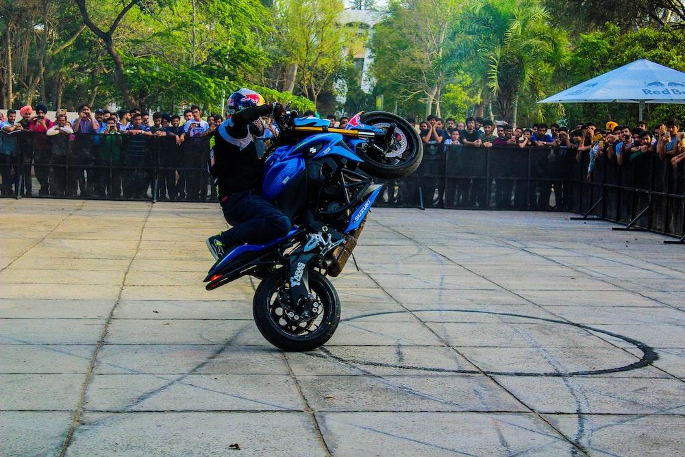 man riding sportsbike making tricks