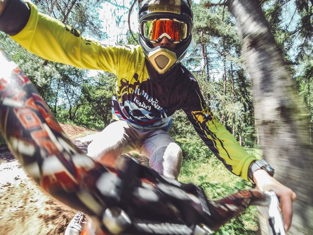 MTB Rider jumping in the forrest in high speed