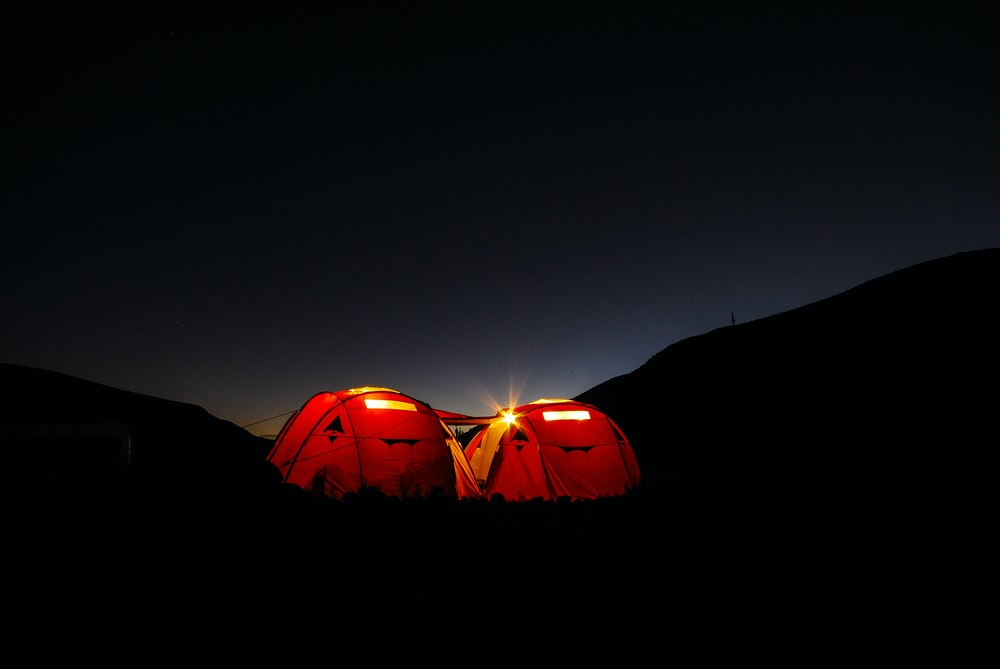 two red tents during nighttime