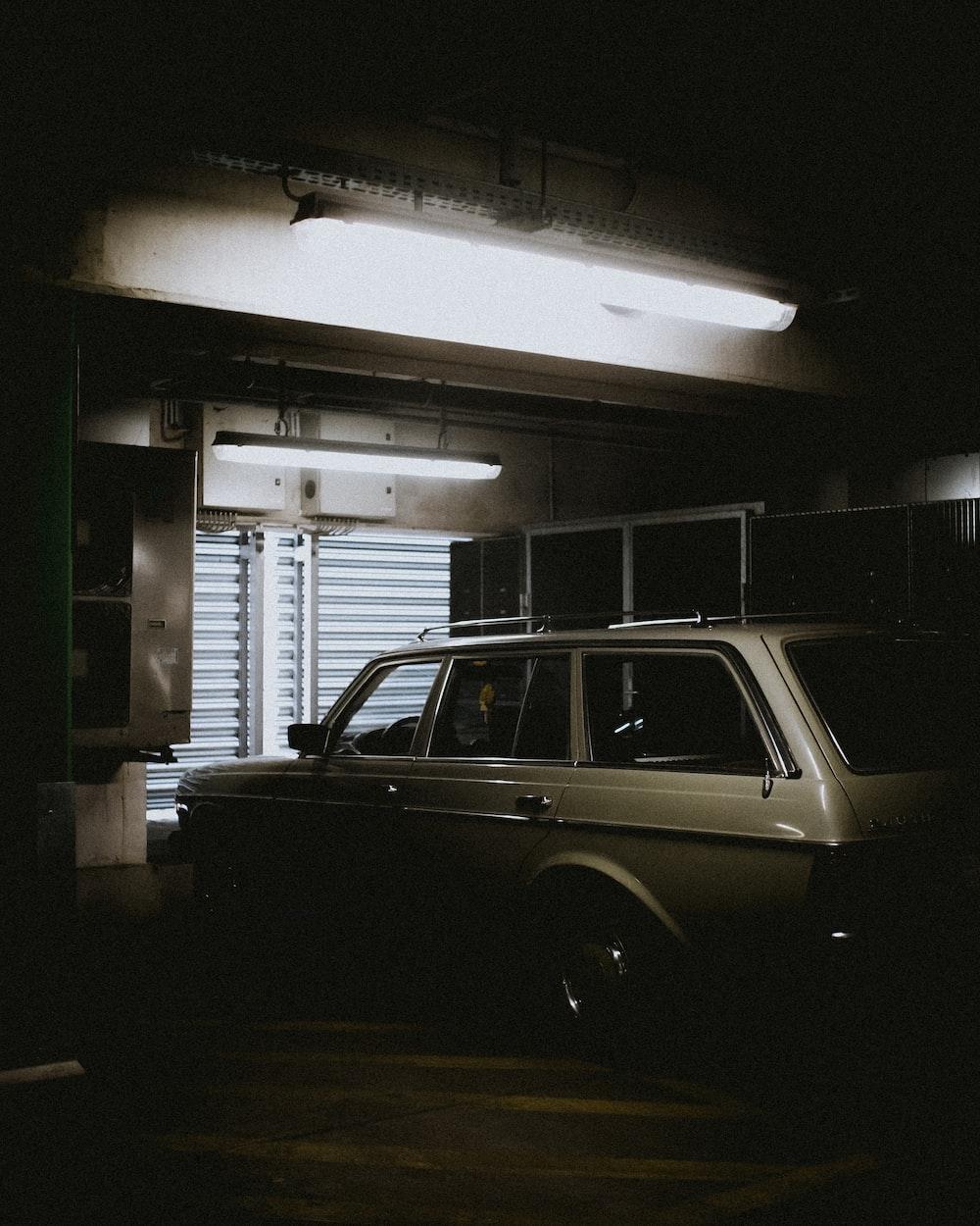 gray car parked beside shutter door