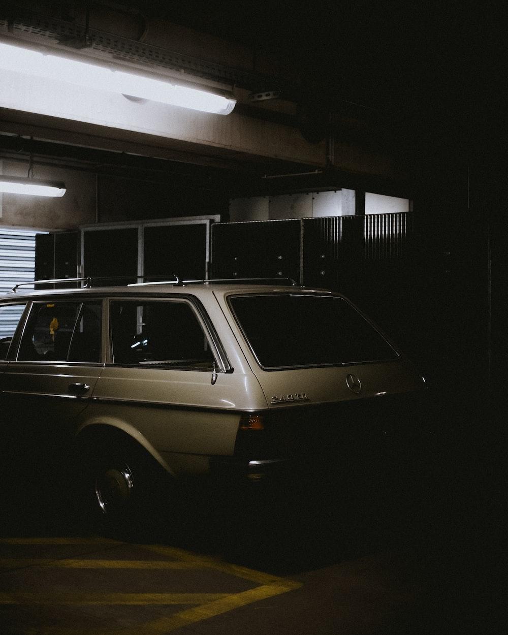white 5-door hatchback parking inside building