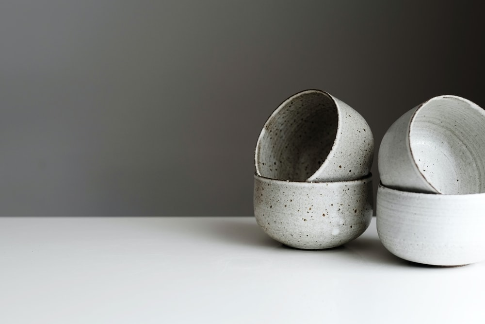 shallow focus photo of gray ceramic bowls