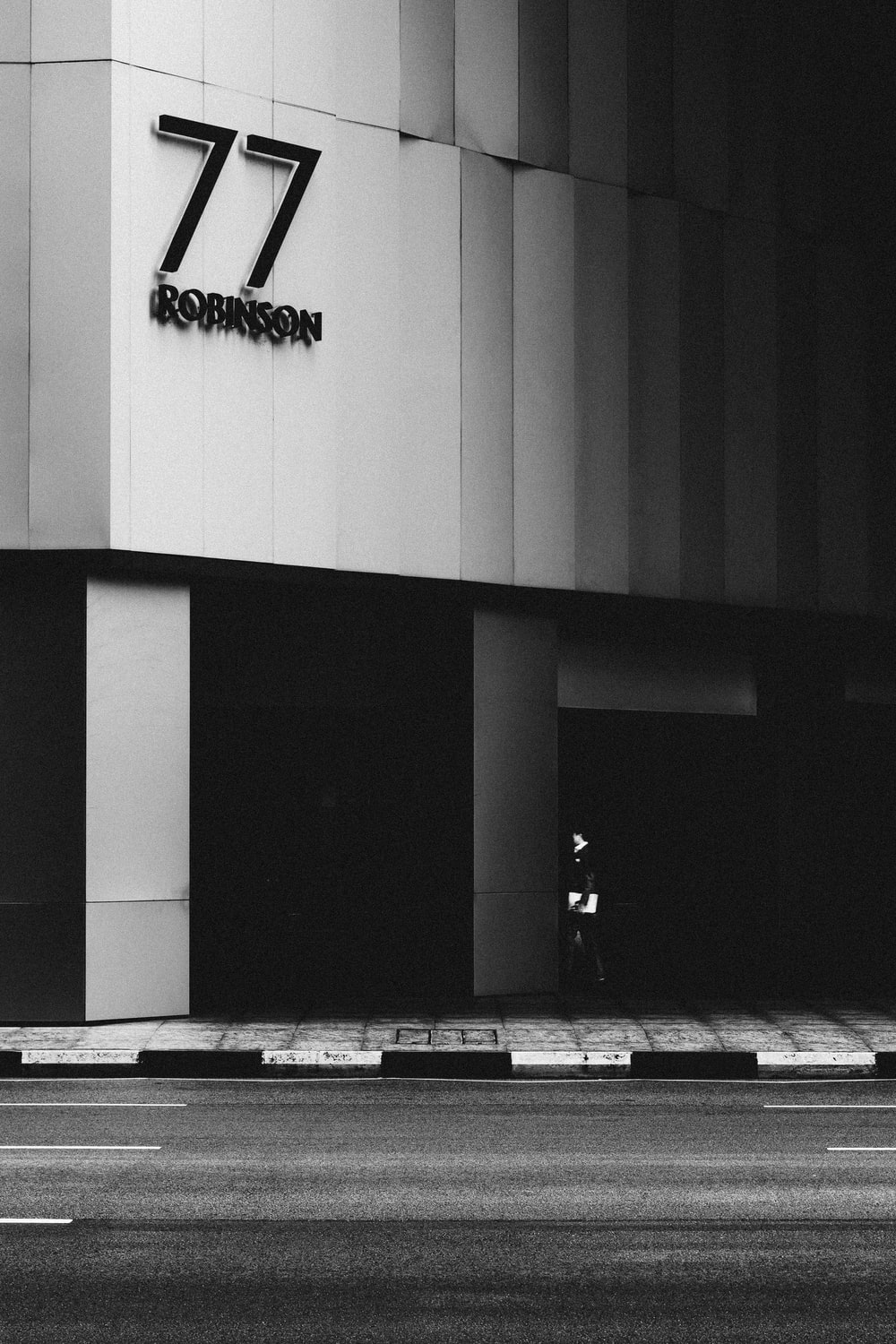 grayscale photo of building with 77 number